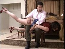 Spanking Videos - She finds herself over his knee
