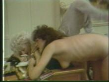 The two friends are lying over the desk side by side during spanking interview II
