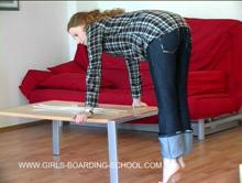 Spanking Videos - he canes her trousered bottom