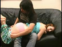 He bends her over for an otk spanking
