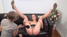 Her legs are wide apart in the spank & spread position